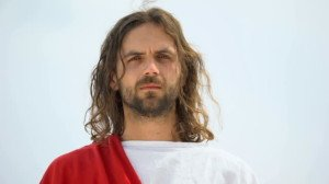 Jesus crying and looking into camera, feeling compassion for people, mercy